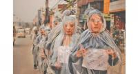 Student artists wrapped in plastic sheets raise awareness about rising pollution levels of Kathmandu.
