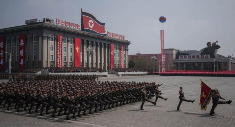 Korean People's Army (KPA) soldiers watch a military parade marking the 105th anniversary of the birth of late North Korean leader Kim Il-Sung, in Pyongyang on April 15, 2017. / AFP PHOTO