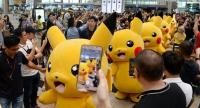 (FILES) This file photo taken on November 18, 2016 shows fans gathering to watch the Pokemon Go virtual reality game mascot Pikachu parade during a promotional event at the Changi International airport terminal in Singapore. / AFP PHOTO