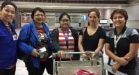 Jean Belmonte, second right, with IOM Philippines officials on her arrival at Manila airport on April 4.
