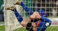 Barcelona's Argentinian forward Lionel Messi falls down under the net of Real Sociedad's goal during the Spanish league football match FC Barcelona vs Real Sociedad at the Camp Nou stadium in Barcelona on April 15, 2017. / AFP PHOTO / LLUIS GENE
