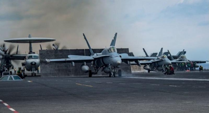 This US Navy handout photo obtained April 12, 2017 shows an F/A-18C Hornet as it prepares to launch from the aircraft carrier USS Carl Vinson (CVN 70) on April 8, 2017 in the South China Sea.  / AFP PHOTO / US NAVY