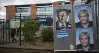 Posters of French presidential election candidate for the far-right Front National (FN) party, Marine Le Pen, adorn billboards outside the polling station in which she is due to cast her ballot, on the eve of election day, in Henin-Beaumont./ EPA