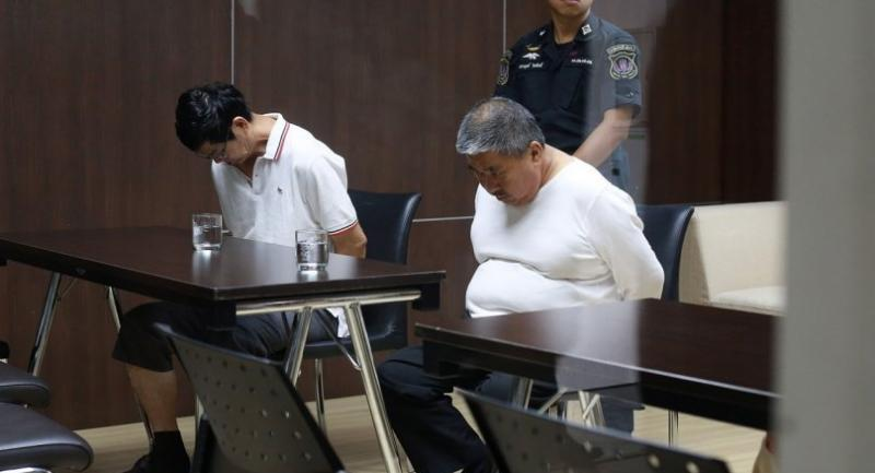 File photo : Two foreign suspects arrested during the crackdown.