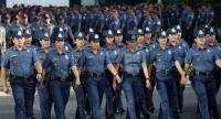 Members of the Philippine National Police march in formation inside the national police headquarters in Quezon city, east of Manila, Philippines, on April 24.//EPA