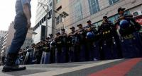 Filipino anti-riot police stand in formation as they wait for protestors marching toward the vicinity of the Association of South East Asian Nations (ASEAN) Summit venue in Manila, Philippines, Friday. EPA