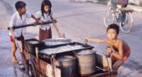 Water was usually not available from taps. These children helped with the very difficult job of collecting it from ponds and rivers.  Photo/John Burgess