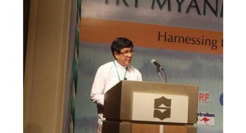 Aung Htoo, deputy minister for commerce, delivers a speech at the TRT Myanmar Rice Network conference yesterday.