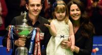 England's Mark Selby poses for a photograph with with the trophy, with his daughter Sofia Maria and wife Vikki, after beating Scotland's John Higgins in the World Championship Snooker final .