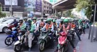 GrabBike (Win) motorbike taxi riders are ready for business with the launch of services in Bangkok.