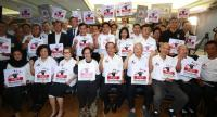 Journalists, media representatives and foreign envoys gather yesterday at the Thai Journalists Association headquarters to mark World Press Freedom Day and show their opposition to the controversial media regulation bill passed by the National Reform
