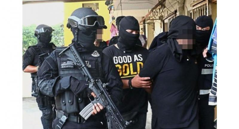 Pulling 'em in: (From top to bottom) Officers from the Bukit Aman Counter Terrorism Division arresting a 41-year-old man in Penang, a 32-year-old factory technician in Johor and a 26-year-old student at the KL International Airport.