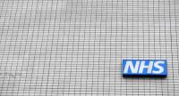 This file photo taken on March 08, 2017 shows a NHS (National Health Service) sign pictured outside St Thomas' Hospital in central London. Several British hospitals were hit by a cyber attack Friday./ AFP PHOTO / BEN STANSALL