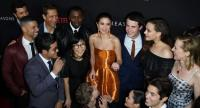 This file photo taken on March 30, 2017 shows actress/singer Selena Gomez (C) surrounded by cast members as they arrive for the premiere Of Netflix's '13 Reasons Why' at Paramount Pictures Studio in Los Angeles, California on March 30, 2017. / AFP