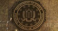The seal of the Federal Bureau of Investigation hangs on the outside of the bureau's Edgar J. Hoover Building May 9, 2017 in Washington, DC. /AFP