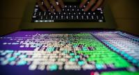 A programer shows a sample of a ransomware cyberattack on a laptop in Taipei, Taiwan. // EPA PHOTO