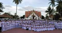 About 300 nurses gather in the yard in front of Phumin Temple in Nan province yesterday to press their demand that the government recruit more nurses as permanent civil servants.