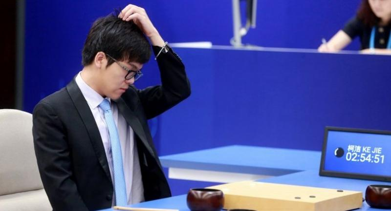 China's 19-year-old Go player Ke Jie reacts during the first match against Google's artificial intelligence programme AlphaGo in Wuzhen, east China's Zhejiang province on Tuesday. / AFP PHOTO
