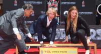 Filmmaker Michael Bay places his hands in the block of cement at his Hand and Foot prints ceremony in front of the TCL Chinese Theater in Hollywood, California on May 23, / AFP PHOTO / FREDERIC J. BROWN