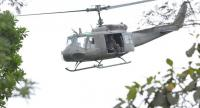A military helicopter flies out of a Philippine miliary camp as fighting rages nearby in Marawi, on the southern island of Mindanao on Thursday./AFP
