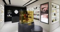 """Azuma Makoto's dramatic floral installation  """"Flowers in Oil"""" commands attention in the store."""