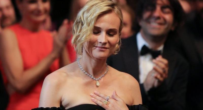 German actress Diane Kruger reacts after she won the Best Actress Prize for her part in 'Aus dem Nichts' (In the Fade) on May 28, 2017 during the closing ceremony of the 70th edition of the Cannes Film Festival in Cannes, southern France. / AFP