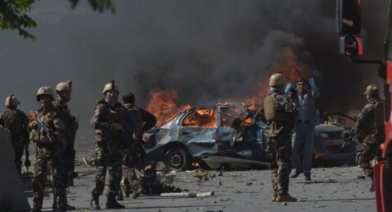 Afghan security forces personnel are seen at the site of a car bomb attack in Kabul on May 31, 2017. // AFP PHOTO