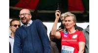 Belgian Prime Minister Charles Michel reacts as Princess Astrid of Belgium gives the start of the 38th edition of the Brussels' 20km run.//AFP