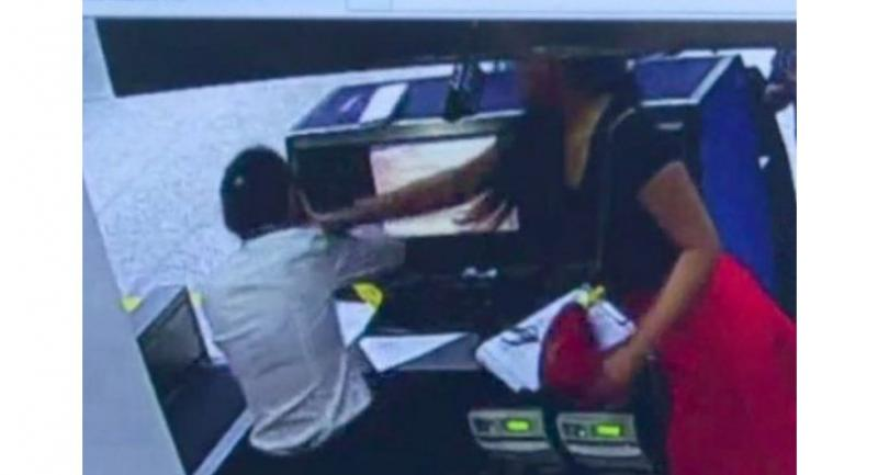 The woman seen on surveillance camera footage striking the staff member. //Photo: Handout.