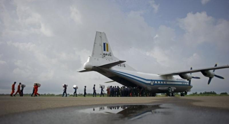 This file photo taken on August 5, 2015 shows a Myanmar Air Force Shaanxi Y-8 transport aircraft similar to the aircraft carrying over 100 people that went missing between the southern city of Myeik  and Yangon Wednesday./AFP