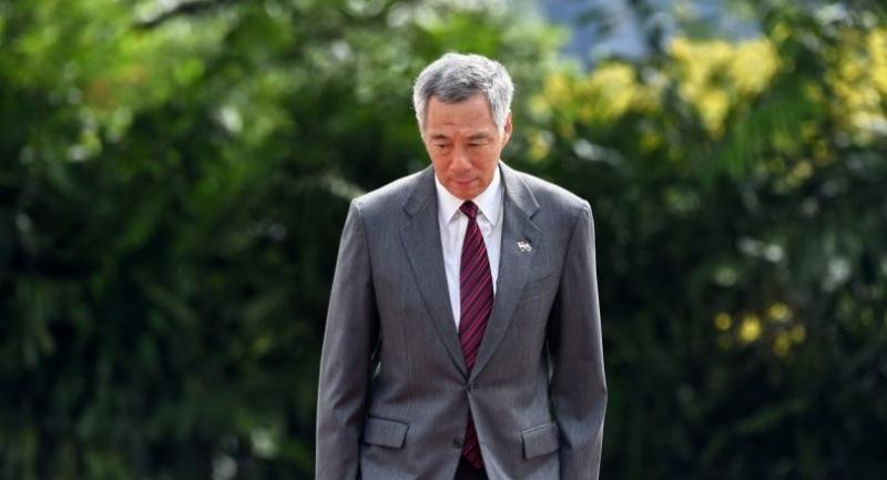 This photograph taken on June 2, 2017 shows Singapore prime minister Lee Hsien Loong at an event at the Istana presidential palace in Singapore.// AFP PHOTO / ROSLAN RAHMAN