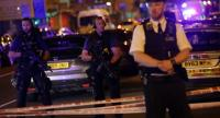 Police guard a street in the Finsbury Park area of north London where a vehichle hit pedestrians on June 19, 2017./AFP