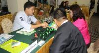 A Thai firm explains its products to potential partners at a business-matching function in Yangon.