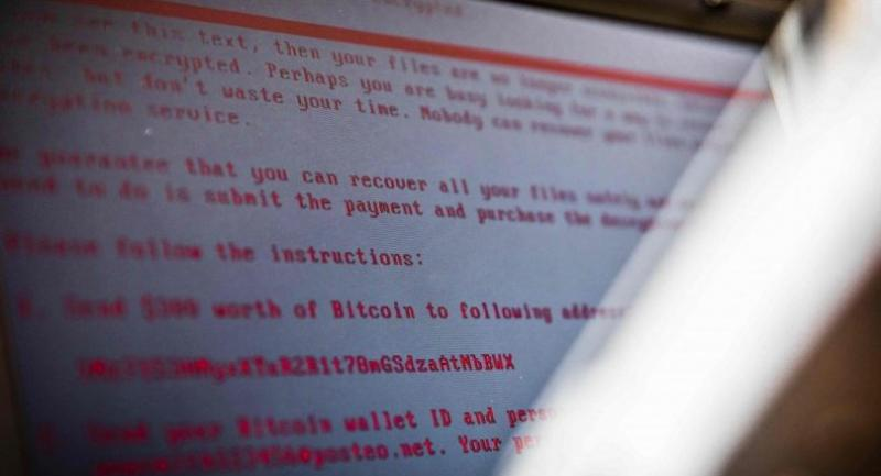 A laptop displays a message after being infected by a ransomware as part of a worldwide cyberattack on June 27, 2017 in Geldrop.  // AFP PHOTO