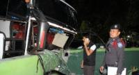 Scenes from the carnage of yet another fatal tour bus accident on Patong Hill. Photo: Kritsada Mueanhawong