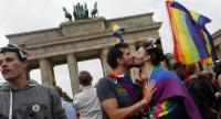 A pair kisses in front of the Brandenburg Gate as they celebrate the legalisation of the same sex marriage approved by the German Parliament (Bundestag) earlier, in Berlin, Germany, 30 June 2017. // EPA PHOTO