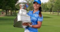 Danielle Kang poses with the championship trophy after winning the 2017 KPMG PGA Championship at Olympia Fields Country Club.