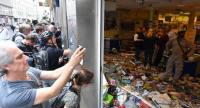 People take pictures of a vandalised supermarket in the 'Schanzenviertel' during the G-20 summit in Hamburg, Germany, 08 July 2017.  // EPA PHOTO