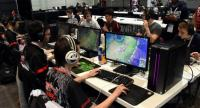 Video game players competes against each other, at the Palais des Congres in Bordeaux during the eSports World Convention (ESWC) Summer edition, on July 2, 2017./AFP