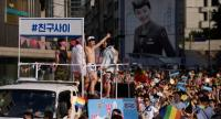 File photo of June 28, 2015 showed participants dance and wave banners during a gay pride parade as part of the 'Korea Queer Festival' in Seoul.//AFP