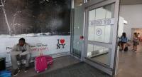 Travelers wait at International Terminal Four at John F. Kennedy International Airport in Queens, New York, USA, 30 June 2017. / EPA