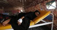 (File) A cholera-infected Yemeni woman receives treatment amid an acute cholera outbreak, inside a makeshift tent at a hospital in Sana�a, Yemen, 22 July 2017. // EPA PHOTO