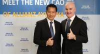 Virong Patanakumjorn, left, chief agency officer at Allianz Ayudhya, and the company's president and chief executive Bryan Smith.