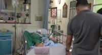 Kittisak Khomkham , 43, under police's watch at Angthong Hospital.