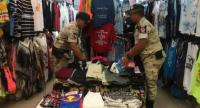 During the raid, officers seized 458 pirated items valued at about 300,000 baht. Photo: Kritsada Mueanhawong