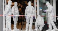 Police investigator work at the area around a supermarket in the northern German city of Hamburg, where a man killed one person and wounded several others in a knife attack, on July 28, 2017./AFP