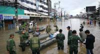 Military officers are sent to help evacuate local residents affected by flooding in Sakon Nakhon yesterday.