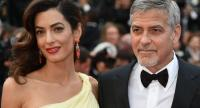 File photo dated May 12, 2016 shows US actor George Clooney (L)and his wife Amal Clooney at the 69th Cannes Film Festival in Cannes, southern France. /AFP