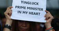 A supporter hold a placard in solidarity with former prime minister Yiingluck Shinawatra in front  of the Supreme Court Tuesday morning.