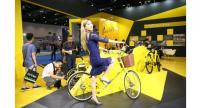 A woman tries out an Ofo bike at an industry expo in Beijing.